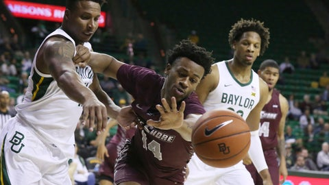 <p>               Maryland-Eastern Shore forward Bruce Guy, right, pushes off on Baylor guard Mark Vital, left, while reaching for a loose ball in the first half of an NCAA college basketball game,  Tuesday, Dec. 3, 2019, in Waco, Texas. (AP Photo/Rod Aydelotte)             </p>