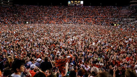 <p>               Auburn fans storm the field after they defeated Alabama 48-45 in an NCAA college football game Saturday, Nov. 30, 2019, in Auburn, Ala. (AP Photo/Butch Dill)             </p>