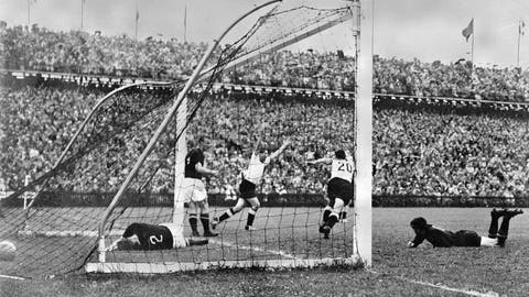 <p>               FILE - In this July 4, 1954 file photo, West Germany's Helmut Rahn, center with arms raised, celebrates after equalising in the World Cup soccer final match against Hungary, at Wankdorf Stadium, in Bern, Switzerland. The stadium in Switzerland that staged the 1954 World Cup final is getting its original name back. Swiss champion Young Boys says a new sponsorship deal sees the historic Wankdorf Stadium name restored. It was rebranded Stade de Suisse after being rebuilt for Euro 2008. (AP Photo, File)             </p>