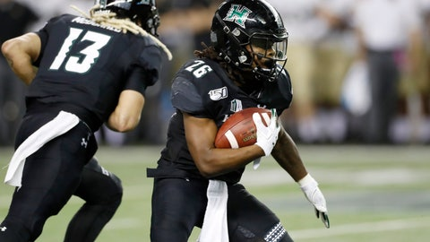 <p>               Hawaii running back Miles Reed (26) runs through the Army defense during the second half of an NCAA college football game Saturday, Nov. 30, 2019 in Honolulu. (AP Photo/Marco Garcia)             </p>