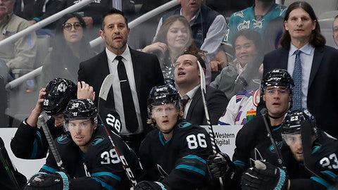 <p>               San Jose Sharks interim coach Bob Boughner, upper left, watches during the first period of an NHL hockey game against the New York Rangers, Thursday, Dec. 12, 2019, in San Jose, Calif. (AP Photo/Ben Margot)             </p>