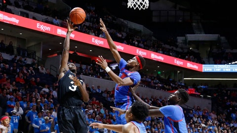 Butler guard Kamar Baldwin (3) shoots over Mississippi guard Devontae Shuler (2) during the first half of an NCAA college basketball game in Oxford, Miss., Tuesday, Dec. 3, 2019. (AP Photo/Rogelio V. Solis)