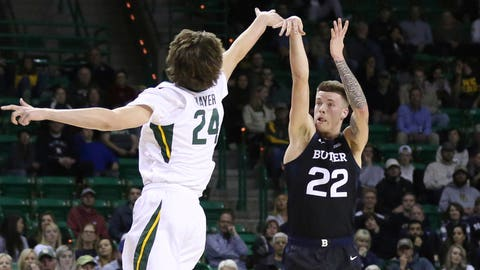 Butler forward Sean McDermott, right, shoots over Baylor guard Matthew Mayer, left, in the first half of an NCAA college basketball game, Tuesday, Dec. 10, 2019, in Waco, Texas. (AP Photo/Rod Aydelotte)