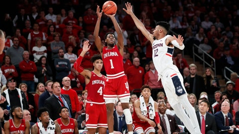 Indiana guard Al Durham (1) shoots with Connecticut guard James Bouknight (12) defending during the second half of an NCAA college basketball game in the Jimmy V Classic, late Tuesday, Dec. 10, 2019, in New York. Indiana defeated UConn 57-54. (AP Photo/Kathy Willens)