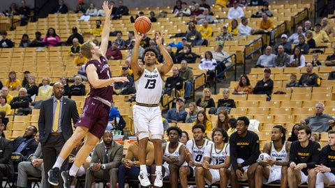 Missouri's Mark Smith (13) shoots a three-point basket past Southern Illinois' Marcus Domask, left, in front of the the Missouri bench during the second half of an NCAA college basketball game Sunday, Dec. 15, 2019, in Columbia, Mo. (AP Photo/L.G. Patterson)