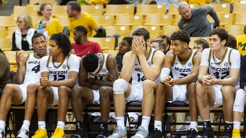 Missouri basketball players watch the final minute of their 68-60 loss to Charleston Southern in an NCAA college basketball game from the bench Tuesday, Dec. 3, 2019, in Columbia, Mo. (AP Photo/L.G. Patterson)