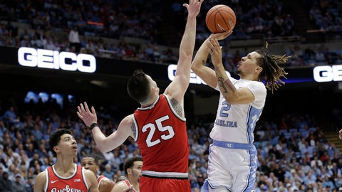 <p>               Ohio State guard D.J. Carton (3) and forward Kyle Young (25) defend while North Carolina guard Cole Anthony (2) shoots during the first half of an NCAA college basketball game in Chapel Hill, N.C., Wednesday, Dec. 4, 2019. (AP Photo/Gerry Broome)             </p>