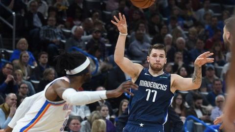 <p>               Dallas Mavericks guard Luka Doncic (77) passes the ball over Oklahoma City Thunder forward Nerlens Noel (9) in the first half of an NBA basketball game, Monday, Jan. 27, 2020, in Oklahoma City. (AP Photo/Kyle Phillips)             </p>