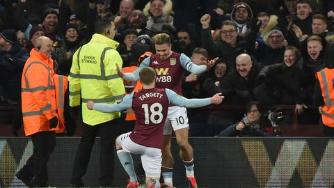 <p>               Aston Villa's Matt Targett, (18) is congratulated by teammate Aston Villa's Jack Grealish after scoring the opening goal of the game during the English League Cup semifinal 2nd leg soccer match between Aston Villa and Leicester City and at the Villa'Park in Birmingham, England, Tuesday, Jan. 28, 2020. (AP Photo/Rui Vieira)             </p>