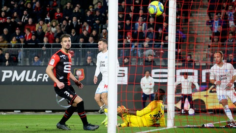 <p>               Marseille's Kevin Strootman, second left, scores his side's opening goal during the League One soccer match between Rennes and Marseille, at the Roazhon Park stadium in Rennes, France, Friday, Jan. 10, 2020. (AP Photo/David Vincent)             </p>