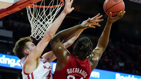 <p>               Wisconsin's Tyler Wahl (5) blocks out Nebraska's Yvan Ouedraogo (24) during the first half of an NCAA college basketball game Tuesday, Jan. 21, 2020, in Madison, Wis. (AP Photo/Andy Manis)             </p>