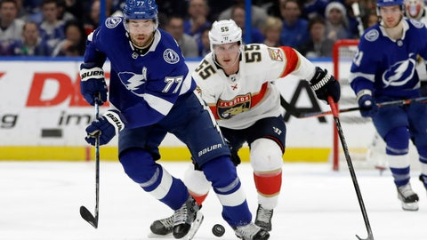 <p>               Tampa Bay Lightning defenseman Victor Hedman (77) moves the puck in front of Florida Panthers center Noel Acciari (55) during the first period of an NHL hockey game Monday, Dec. 23, 2019, in Tampa, Fla. (AP Photo/Chris O'Meara)             </p>