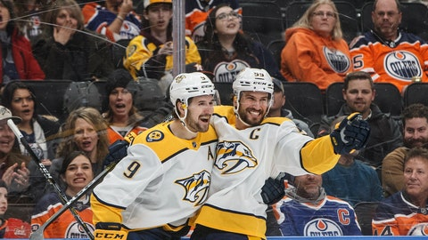 <p>               Nashville Predators' Filip Forsberg (9) and Roman Josi (59) celebrate a goal during first period NHL hockey action against the Edmonton Oilers in Edmonton, Alberta, Tuesday, Jan. 14, 2019. (Jason Franson/The Canadian Press via AP)             </p>