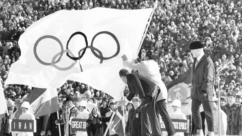 <p>               FILE - In this  Feb. 3, 1972, file photo, the white five-ringer Olympic flag, which has been in the custody of Genoble since the winter games in 1968, is handed over by French skier Ingrid Lafforgue, with due ceremony in Sapporo. The city of Sapporo is the first to officially bid for the 2030 Winter Olympics and becomes the early favorite after the Japanese Olympic Committee approved its candidate file late Wednesday, Jan. 29, 2020. Sapporo was host to the 1972 Winter Olympics and could face competition from Salt Lake City in the United States, which is also being mentioned as a possible bidder, along with Barcelona and a bid tied to the Pyrenees. At right is Avery Brundage, the president of the IOC. (AP Photo, File)             </p>