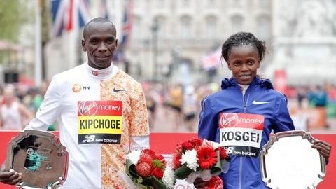 <p>               FILE - In this Sunday, April 28, 2019 file photo, women's race winner Kenya's Brigid Kosgei, right, and men's race winner Kenya's Eliud Kipchog pose after the 39th London Marathon in London. Olympic marathon champion Eliud Kipchoge was named on Kenya's team on Friday Jan. 31, 2020 to defend his title at this year's Tokyo Games, and Brigid Kosgei will lead Kenya's gold medal hopes in the women's race after she ran 2:14.04  in Chicago last year to break the world record for a woman running in a mixed race. (AP Photo/Alastair Grant, File)             </p>