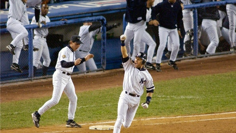 <p>               FIEE - In this Oct. 31, 2001, file photo, New York Yankees' Derek Jeter celebrates his game-winning home run in the 10th inning as he rounds first base in Game 4 of baseball's World Series against the Arizona Diamondbacks at Yankee Stadium in New York. Jeter could be a unanimous pick when Baseball Hall of Fame voting is announced Tuesday, Jan. 21, 2020. (AP Photo/Bill Kostroun, File)             </p>