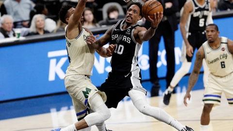 <p>               San Antonio Spurs guard DeMar DeRozan (10) scores against Milwaukee Bucks forward Thanasis Antetokounmpo, left,  during the second half of an NBA basketball game in San Antonio, Monday, Jan. 6, 2020. (AP Photo/Eric Gay)             </p>