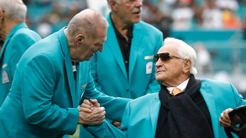<p>               Former Miami Dolphins head coach Don Shula is greeted on the field by former players during half time at an NFL football game against the Cincinnati Bengals, Sunday, Dec. 22, 2019, in Miami Gardens, Fla. The 1972 undefeated team was celebrated on the field. (AP Photo/Brynn Anderson)             </p>