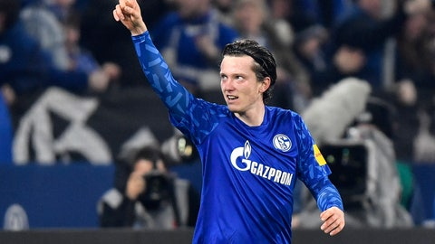<p>               Schalke's Michael Gregoritsch celebrates after scoring his side's second goal during the German Bundesliga soccer match between FC Schalke 04 and Borussia Moenchengladbach at the Arena in Gelsenkirchen, Germany, Friday, Jan. 17, 2020. (AP Photo/Martin Meissner)             </p>