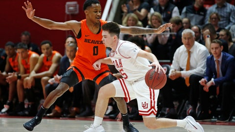 <p>               Utah guard Jaxon Brenchley (5) drives as Oregon State guard Gianni Hunt (0) defends in the first half during an NCAA college basketball game Thursday, Jan. 2, 2020, in Salt Lake City. (AP Photo/Rick Bowmer)             </p>