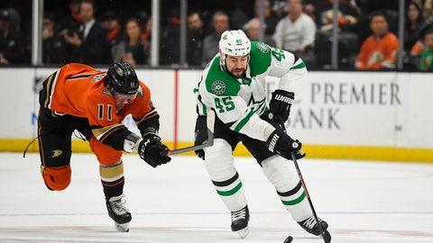 <p>               Anaheim Ducks right wing Daniel Sprong, left, reaches for Dallas Stars defenseman Roman Polak as Polak takes the puck during the first period of an NHL hockey game Thursday, Jan. 9, 2020, in Anaheim, Calif. (AP Photo/Mark J. Terrill)             </p>
