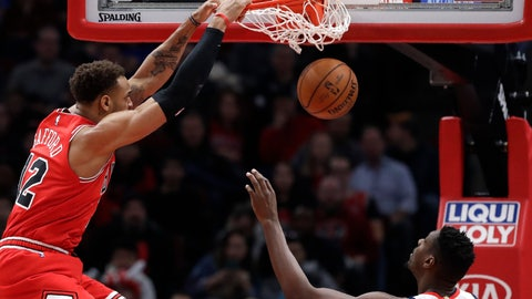 <p>               Chicago Bulls forward Daniel Gafford, left, dunks as Washington Wizards center Ian Mahinmi watches during the first half of an NBA basketball game in Chicago, Wednesday, Jan. 15, 2020. (AP Photo/Nam Y. Huh)             </p>