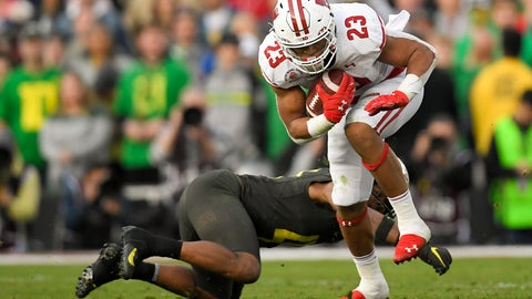 <p>               Wisconsin running back Jonathan Taylor runs past Oregon cornerback Thomas Graham Jr. during second half of the Rose Bowl NCAA college football game Wednesday, Jan. 1, 2020, in Pasadena, Calif. (AP Photo/Mark J. Terrill)             </p>