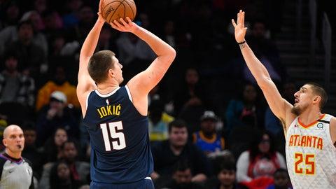 <p>               Denver Nuggets center Nikola Jokic (15) shoots as Atlanta Hawks center Alex Len (25) defends during an NBA basketball game Monday, Jan. 6, 2020, in Atlanta. (AP Photo/John Amis)             </p>
