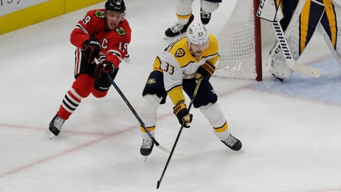 <p>               Nashville Predators right wing Viktor Arvidsson, right, controls the puck against Chicago Blackhawks center Jonathan Toews during the first period of an NHL hockey game in Chicago, Thursday, Jan. 9, 2020. (AP Photo/Nam Y. Huh)             </p>