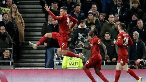<p>               Liverpool's Roberto Firmino, left, celebrates after scoring the opening goal during the English Premier League soccer match between Tottenham Hotspur and Liverpool at the Tottenham Hotspur Stadium in London, England, Saturday, Jan. 11, 2020. (AP Photo/Matt Dunham)             </p>