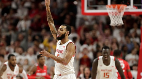 <p>               Maryland guard Eric Ayala gestures after scoring a basket against Ohio State during the first half of an NCAA college basketball game, Tuesday, Jan. 7, 2020, in College Park, Md. (AP Photo/Julio Cortez)             </p>