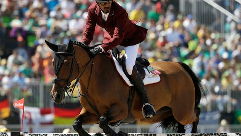 <p>               FILE - In this Wednesday, Aug. 17, 2016 file photo, Qatar's Sheikh Ali Al Thani, riding First Devision, competes in the equestrian jumping competition at the 2016 Summer Olympics in Rio de Janeiro, Brazil. A Qatari sheikh is among two equestrian riders who failed doping tests at an Olympic qualifier, risking the national team's place in the Tokyo Games jumping lineup. Sheikh Ali al-Thani and Bassem Mohammed tested positive for cannabis metabolites at an Olympic qualifying event in Morocco in October, the International Equestrian Federation (FEI) said Thursday, Jan. 9, 2020.  (AP Photo/John Locher, file)             </p>