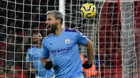 <p>               Manchester City's Sergio Aguero celebrates after scoring his side's opening goal during the English Premier League soccer match between Sheffield United and Manchester City at Bramall Lane in Sheffield, England, Tuesday, Jan. 21, 2020. (AP Photo/Rui Vieira)             </p>