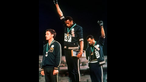 <p>               FILE - In this Oct. 16, 1968 file photo, U.S. athletes Tommie Smith, center, and John Carlos raise their gloved fists after Smith received the gold and Carlos the bronze for the 200 meter run at the Summer Olympic Games in Mexico City. Some athletes are criticizing the International Olympic Committee for prohibiting political protests on the medal podium. Olympic officials reminded athletes last week not to make political statements at the Tokyo Olympics. (AP Photo/File)             </p>