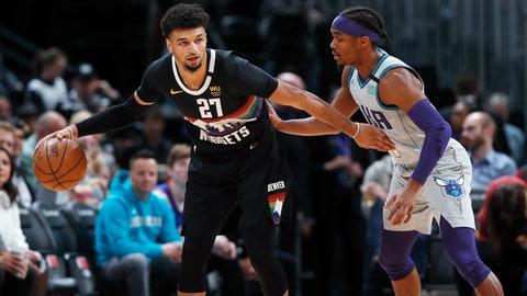 <p>               Denver Nuggets guard Jamal Murray, left, keeps Charlotte Hornets guard Devonte' Graham at bay during the first half of an NBA basketball game Wednesday, Jan. 15, 2020, in Denver. (AP Photo/David Zalubowski)             </p>