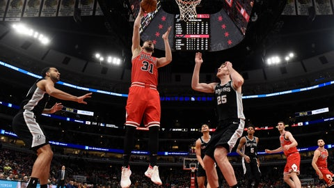<p>               Chicago Bulls guard Tomas Satoransky (31) goes to the basket as San Antonio Spurs center Jakob Poeltl (25) defends him during the first half of an NBA basketball game Monday, Jan. 27, 2020, in Chicago. (AP Photo/David Banks)             </p>