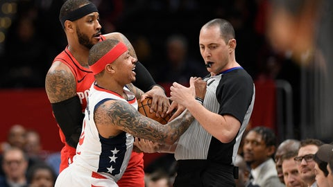 <p>               Washington Wizards guard Isaiah Thomas (4) comes in contact with referee Marat Kogut, right, next to Portland Trail Blazers forward Carmelo Anthony, back, during the first half of an NBA basketball game, Friday, Jan. 3, 2020, in Washington. Thomas was ejected from the game. (AP Photo/Nick Wass)             </p>