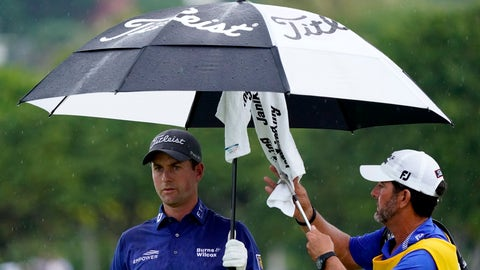 <p>               Webb Simpson keeps dry as his caddie dries off his club on the 13th green during the final round of the Sony Open PGA Tour golf event, Sunday, Jan. 12, 2020, at Waialae Country Club in Honolulu. (AP Photo/Matt York)             </p>