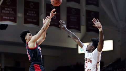 <p>               Louisville forward Jordan Nwora, left, shoots over Boston College forward CJ Felder during the first half of an NCAA college basketball game in Boston, Wednesday, Jan. 29, 2020. (AP Photo/Charles Krupa)             </p>