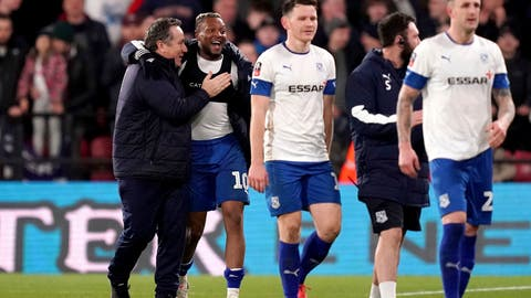 <p>               Tranmere Rovers manager Micky Mellon, left, celebrates with Morgan Ferrier after his side earn a replay with a draw following the English FA Cup third round soccer match between Watford and Tranmere Rovers at Vicarage Road, Watford, England, Saturday, Jan. 4, 2020. (John Walton/PA via AP)             </p>