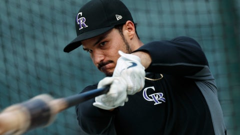 <p>               FILE - In this Sept. 27, 2019, file photo, Colorado Rockies third baseman Nolan Arenado warms up before a baseball game against the Milwaukee Brewers in Denver. Rockies star Arenado said he feels disrespected after Colorado general manager Jeff Bridich acknowledged listening to trade offers for the seven-time Gold Glove winner. Bridich told The Denver Post on Monday, Jan. 20, 2020, that he expected Arenado to be Colorado's third baseman this season after discussing potential deals involving the 28-year-old this winter. The five-time All-Star agreed to a $260 million, eight-year contract with the Rockies last February. (AP Photo/David Zalubowski, File)             </p>