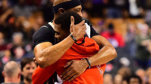 <p>               Atlanta Hawks guard Vince Carter hugs Toronto Raptors guard Kyle Lowry, after Lowry became the franchise leader in assists, during the second half of an NBA basketball game Tuesday, Jan. 28, 2020, in Toronto. (Frank Gunn/The Canadian Press via AP)             </p>