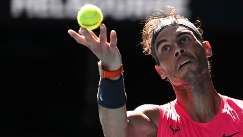 <p>               Spain's Rafael Nadal serves to compatriot Pablo Carreno Busta during their third round singles match at the Australian Open tennis championship in Melbourne, Australia, Saturday, Jan. 25, 2020. (AP Photo/Dita Alangkara)             </p>