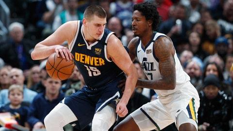 <p>               Denver Nuggets center Nikola Jokic, left, is defended by Utah Jazz center Ed Davis during the second half of an NBA basketball game Thursday, Jan. 30, 2020, in Denver. The Nuggets won 106-100. (AP Photo/David Zalubowski)             </p>