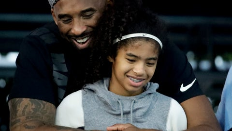 <p>               FILE - In this July 26, 2018 file photo former Los Angeles Laker Kobe Bryant and his daughter Gianna watch during the U.S. national championships swimming meet in Irvine, Calif. Bryant, the 18-time NBA All-Star who won five championships and became one of the greatest basketball players of his generation during a 20-year career with the Los Angeles Lakers, died in a helicopter crash Sunday, Jan. 26, 2020. Gianna also died in the crash. She was 13. (AP Photo/Chris Carlson)             </p>