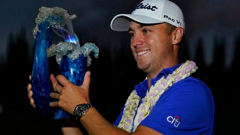 <p>               Justin Thomas holds the champions trophy after winning the Tournament of Champions golf event, Sunday, Jan. 5, 2020, at Kapalua Plantation Course in Kapalua, Hawaii. Thomas won after a three-hole playoff. (AP Photo/Matt York31             </p>
