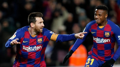 <p>               Barcelona's Lionel Messi, left, celebrates with Ansu Fati after scoring the opening goal during a Spanish La Liga soccer match between Barcelona and Granada at Camp Nou stadium in Barcelona, Spain, Sunday, Jan. 19, 2020. (AP Photo/Joan Monfort)             </p>