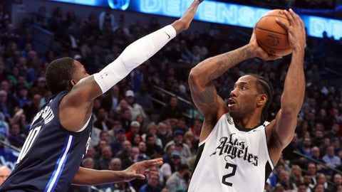 <p>               Dallas Mavericks forward Dorian Finney-Smith (10) tries to defend against a shot by Los Angeles Clippers forward Kawhi Leonard (2) during the second half of an NBA basketball game Tuesday, Jan. 21, 2020 in Dallas. (AP Photo/Richard W. Rodriguez)             </p>