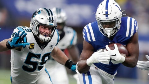 <p>               Indianapolis Colts running back Marlon Mack (25) runs past Carolina Panthers' Luke Kuechly (59) during the first half of an NFL football game, Sunday, Dec. 22, 2019, in Indianapolis. (AP Photo/Michael Conroy)             </p>