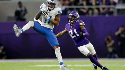 <p>               Detroit Lions wide receiver Marvin Jones catches a pass ahead of Minnesota Vikings cornerback Mike Hughes, right, during the first half of an NFL football game, Sunday, Dec. 8, 2019, in Minneapolis. (AP Photo/Andy Clayton-King)             </p>